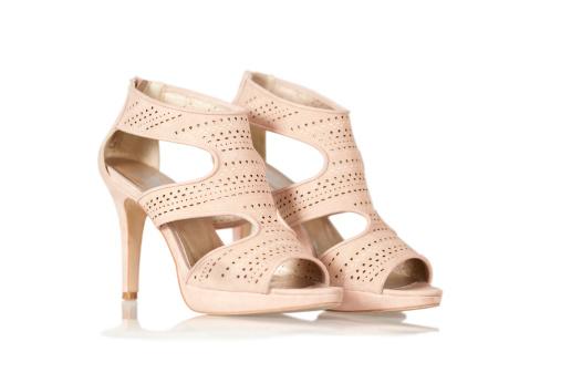 171350744-elegant-high-heels-sandals-in-nude-color-gettyimages.jpg