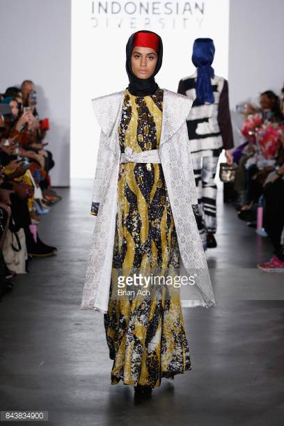 model-walks-the-runway-wearing-dian-pelangi-ss18-during-the-fashion-picture-id843834900
