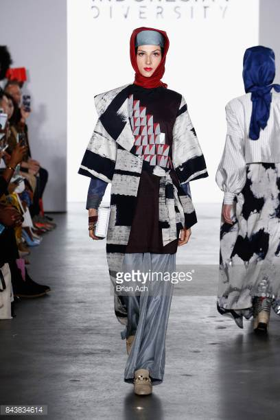 model-walks-the-runway-wearing-dian-pelangi-ss18-ss18-and-handbag-by-picture-id843834614