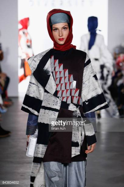 model-walks-the-runway-wearing-dian-pelangi-ss18-ss18-and-handbag-by-picture-id843834652