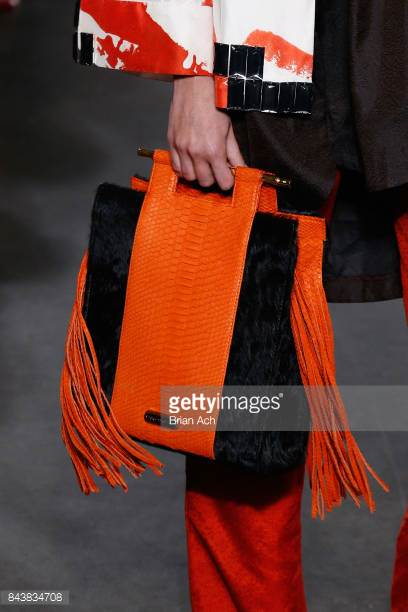 model-walks-the-runway-wearing-dian-pelangi-ss18-ss18-and-handbag-by-picture-id843834708