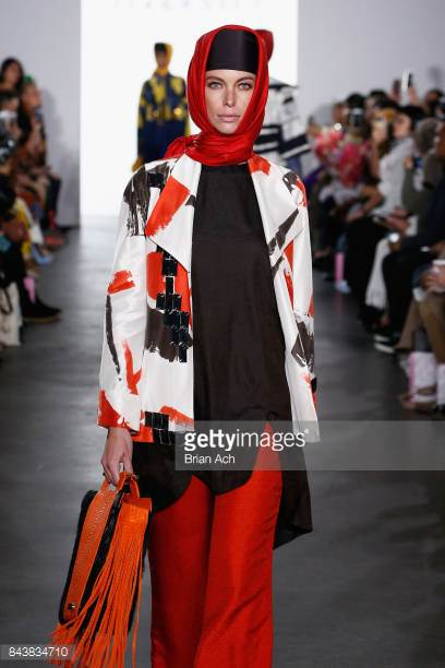 model-walks-the-runway-wearing-dian-pelangi-ss18-ss18-and-handbag-by-picture-id843834710