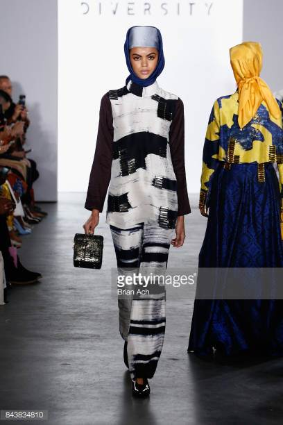model-walks-the-runway-wearing-dian-pelangi-ss18-ss18-and-handbag-by-picture-id843834810